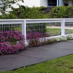wonderful-modern-cool-nice-backyard-fencing-idea-with-white-shorter-concept-made-of-iron-with-wondeful-flower-decoration-around-the-fence