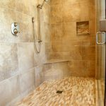 wonderful-nice-adorable-elegant-built-in-shower-with-gold-luxurious-wall-tiles-design-with-large-fixure-design-and-has-small-mounted-chairs