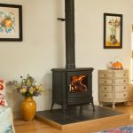wonerful-nice-cool-fantastic-wood-burning-stove-with-small-design-with-long-chimney-concept-made-of-iron-with-black-coloring-choice-728x483