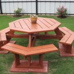 wood-finish picnic table with permanent wood bench