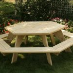 wood picnic table with backless chairs in six-star-shape