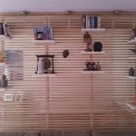 wood room partition end  floating shelves for books and decorative items