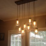 A bunch of pendant lighting fixtures with different hanger length