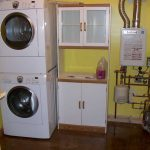 Good installation of tankless water heater in loundry room with double washing machine without take great space