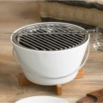 Hibachi grill appliance in white with wooden stand