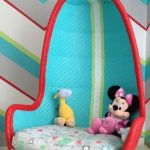 Turquoise and red hanging chair for kids  a minnie mouse and an animal stuff