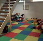 adorable color tiled area rug in under stair kids playroom basement finishing