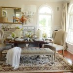 adorable dining space design with white seating idea and tufted bench upon patterned area rug with vintage vanity aside arch windows design and corner storage