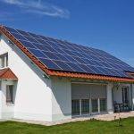 adorable-modern-nice-simple-large-solar-Panels-and-Clay-Tile-covering-all-the-roof-of-small-house-with-white-wall