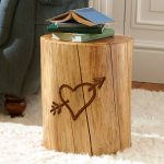 adorable round rustic natural tree stumps side table design with heart shape ornament and books on the countertop