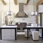 adorable white kitchen cabinet in antique style with black accent and wooden material and modern smokestack beneath tube pendant lamps and rustic pergola on white ceiling