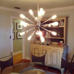 amazing blossom white alen and roth chandelier upon dining table with classic chairs aside rustic wooden storage and glass round table