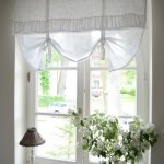 amazing cottage style windows with fancy window treatment of white curtain drapery plus white wood material and table lamp beautified with flower vase