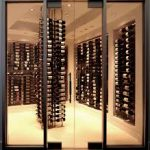 amazing modern wine cellar design with wall racks and stunning vertical wine storage design inside glass room with cream flooring idea and modern lighting