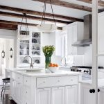 amazing white cabinet designin kitchen with transparent storage idea and small boxy kitchen iland beneath lopping pendants and a vas of beautiful flower and rustic pergola on the ceiling