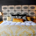 amazing yellow bedding set with floral patterned suilt and tufted bed and colorful pillows beneath decorative headboard flanked between two nightstand with double table lamps