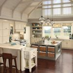 antique kitchen cabinet idea beneath sloping white ceiling design with open racks and grey countertop and boxy kitchen island with white bar and brown wooden stools upon brown laminated floor