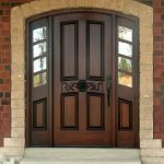 arched wooden door casing design made of brick among reddish brick wall with pella storm door upon white flooring idea