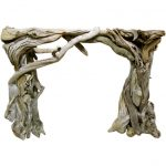 Artistic And Original Driftwood That Is Designed Into A Mantle Fireplace