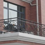 artistic black iron railing for balcony red bricks wall system large windows glass with black frames