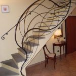 artistic iron railing for stairway a console table with table lamp a wood chair