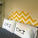 Astonishing Yellow Chevron Patterned Headboard Idea Above White Pillows With Glasses Pattern Upon Navy Blue Bedding