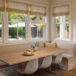 Banquette Seating Ideas With Build In Bench And Long Wooden Table And White Chairs Plus Cushions And Glass Windows With Drapery And Pendant Lamp Plus Wooden Floor