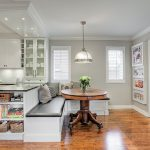 Banquette Seating Ideas With Build In Bench Plus Cushions With Round Wooden Table And Stylish Pendant Lighting And Wooden Floor Plus Kitchen