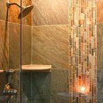 bathroom remodelling with glass walk in shower plus impressive natural wall tiles