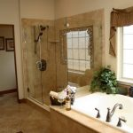 bathroom remodelling with large bathtub and glass walk in shower plus windows with drapery and floor tile