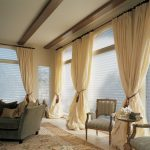 beautiful window treatments nyc with lovely beige curtains and blinds in living room with comfortable sofa and armchair plus rug