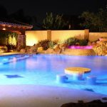 best backyard pools with amazing lighting and cool stone around the poo; and small jacuzzy and living space area and mini water fountain