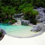 Best Backyard Pools With Like Beach Panorama Plus Sand And Natural Stone Combined With Beautiful Flower Garden And Plants