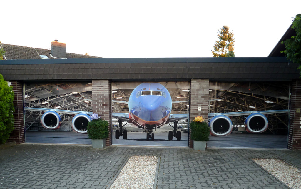 Best Unique Garage Doors With Plane Picture Theme Plus Brick Wall And Paver Combined