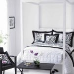 black and white bedroom ideas with bed and pretty bedding set plus wooden table and chairs plus picture on wall and flower pots