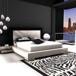 black and white bedroom ideas with white black panel bed and zebra rug plus cool pendant lamps plus chest of drawers and vases