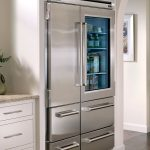 built in microwave drawer in stainless steel a metal surface refrigerator marble kitchen countertop a
