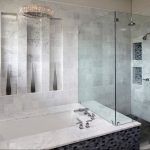 built-in small tub  high built-in shelves  frameless glass door shower space with built-in shelves with mosaic tiles back