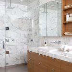 Classy And Gorgeous Bathroom Design With Dominant Carrara Marble Material For Floor Wall  A Frameless Glass Door Shower Space Floating Cabinets With Mirror Door A Vanity With Square Sinks And Faucet