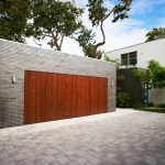 cool garage doors with wooden panel plus hard brick wall and brick paver pattern combined with modern hose with garden