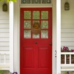 cool red front door design with patterned glass accent and bar style with rattan basket accessory between two side white wooden deck wall for entrance