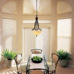 cool window treatments nyc with blinds in dining room with glass top table and cool chairs beautified with plant pot