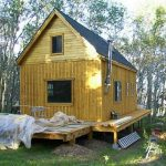 creative-cool-natural-fresh-green-mall-rustic-cabin-plan-with-simpe-wooden-body-with-black-roofing-with-green-environment-choice