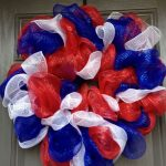 creative fourth of july wreath made from red blue white shower puffs