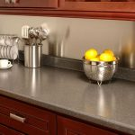 creative laminate finishing in granite look for kitchen counter a bunch of fresh lemons cup and mini plate organizer made from stainless steel