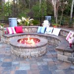 creative-nice-small-simple-patio-with-fire-pit-permanent-patio-fire-pits-with-half-round-seat-with-pillows-made-of-squared-rocks