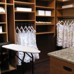 custom closets nyc califoria with wardrobe and shoe boxes and iron board plus table