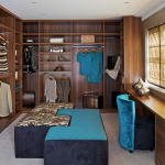 custom closets nyc with wood material for wardrobe plus briefcase and sofa stool at the center and vase