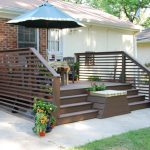 dark finished wood horizontal deck with wood outdoor furniture and big shade