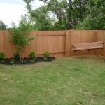 dark stained wood lattice fence system for backyard a wood swinger near the fence
